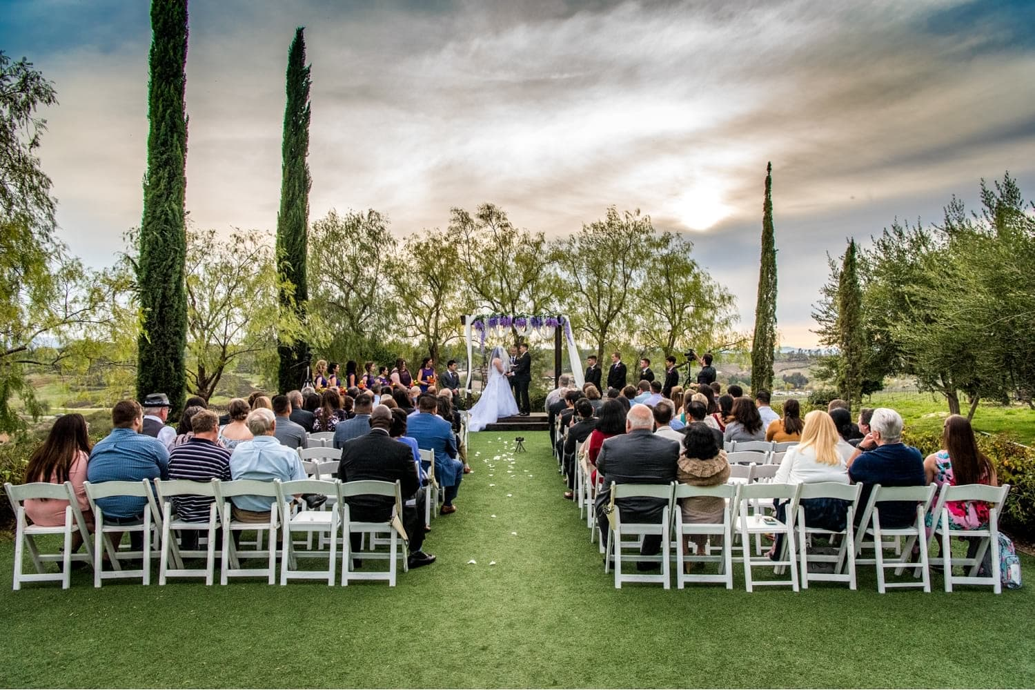 Wedding ceremony with guests at Falkner Winery.