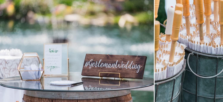 Wedding details including umbrellas and a sign.
