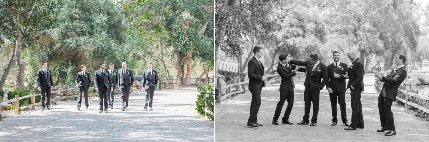 Groom and groomsmen walking down a path.