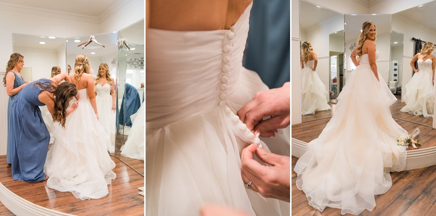 Bride getting her dress on.