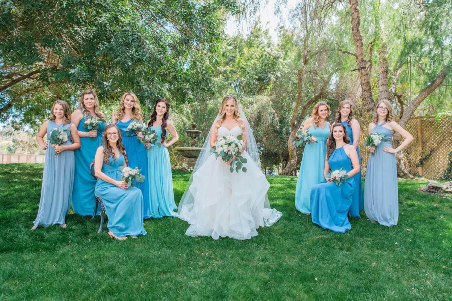 Bride and her bridesmaids doing a vanity fair pose.