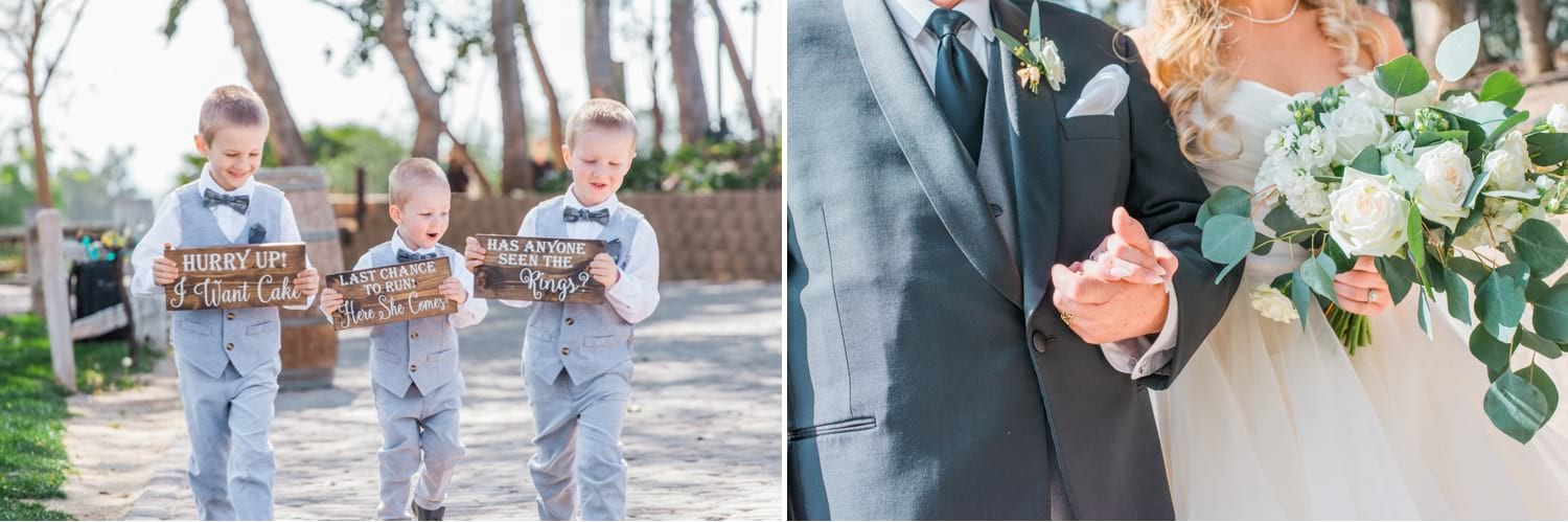 Ring bearers holding signs down the aisle.