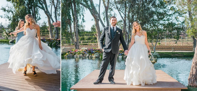 Bride and groom posing on dock at Lake Oak Meadows.