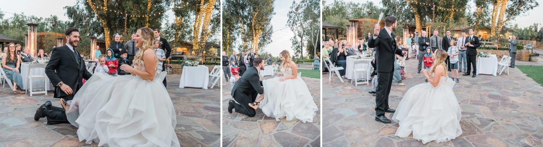 Groom retrieving bride's garter for the garter toss.
