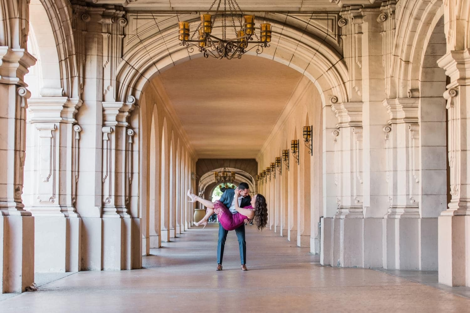 Engagement Photo in a hallway at Balboa Park.