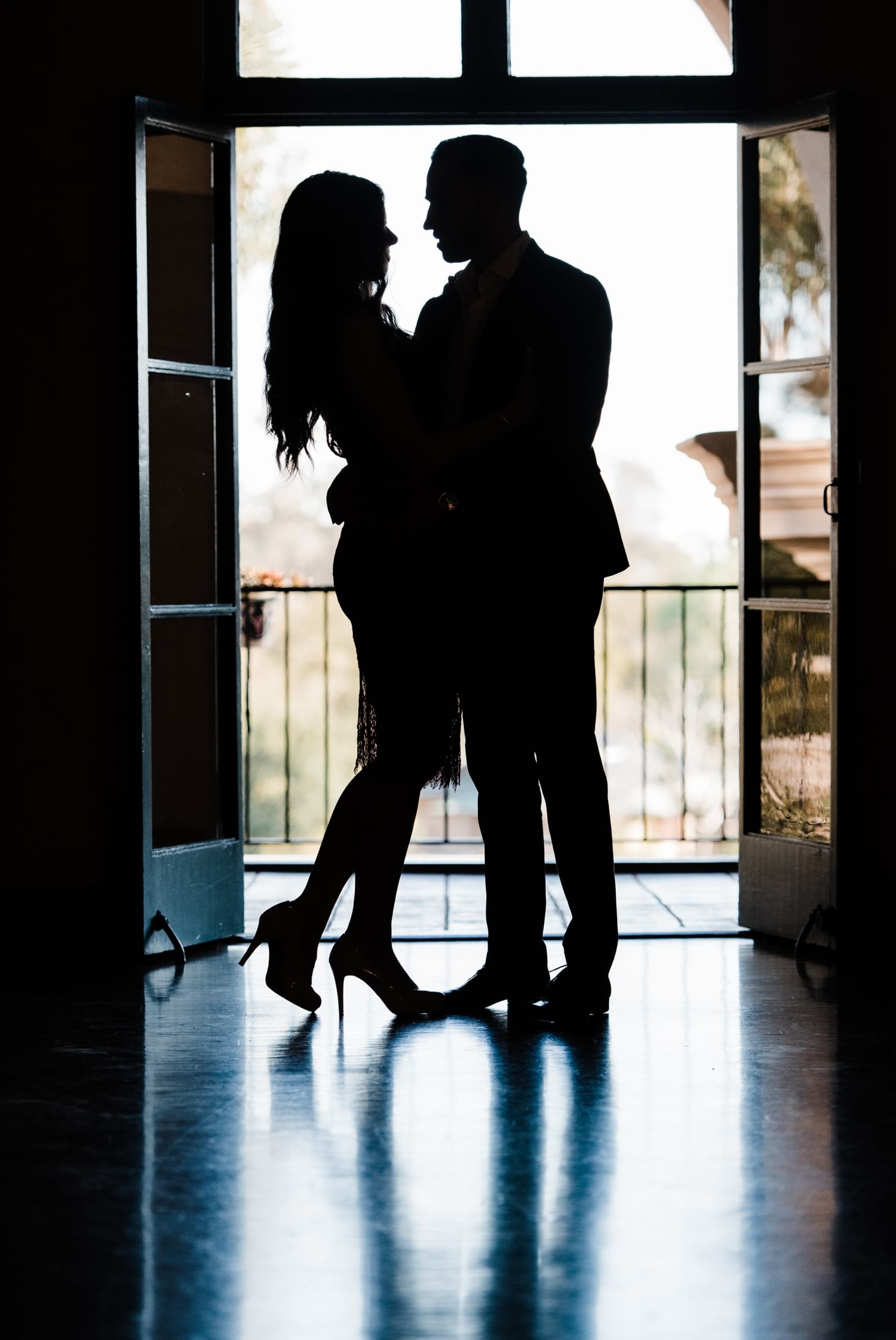 Silhouette of couple in doorway at Balboa Park.