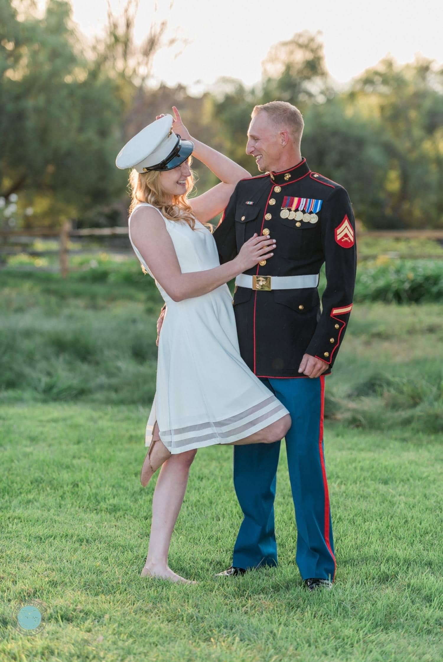 Bride wearing her groom's marine hat.