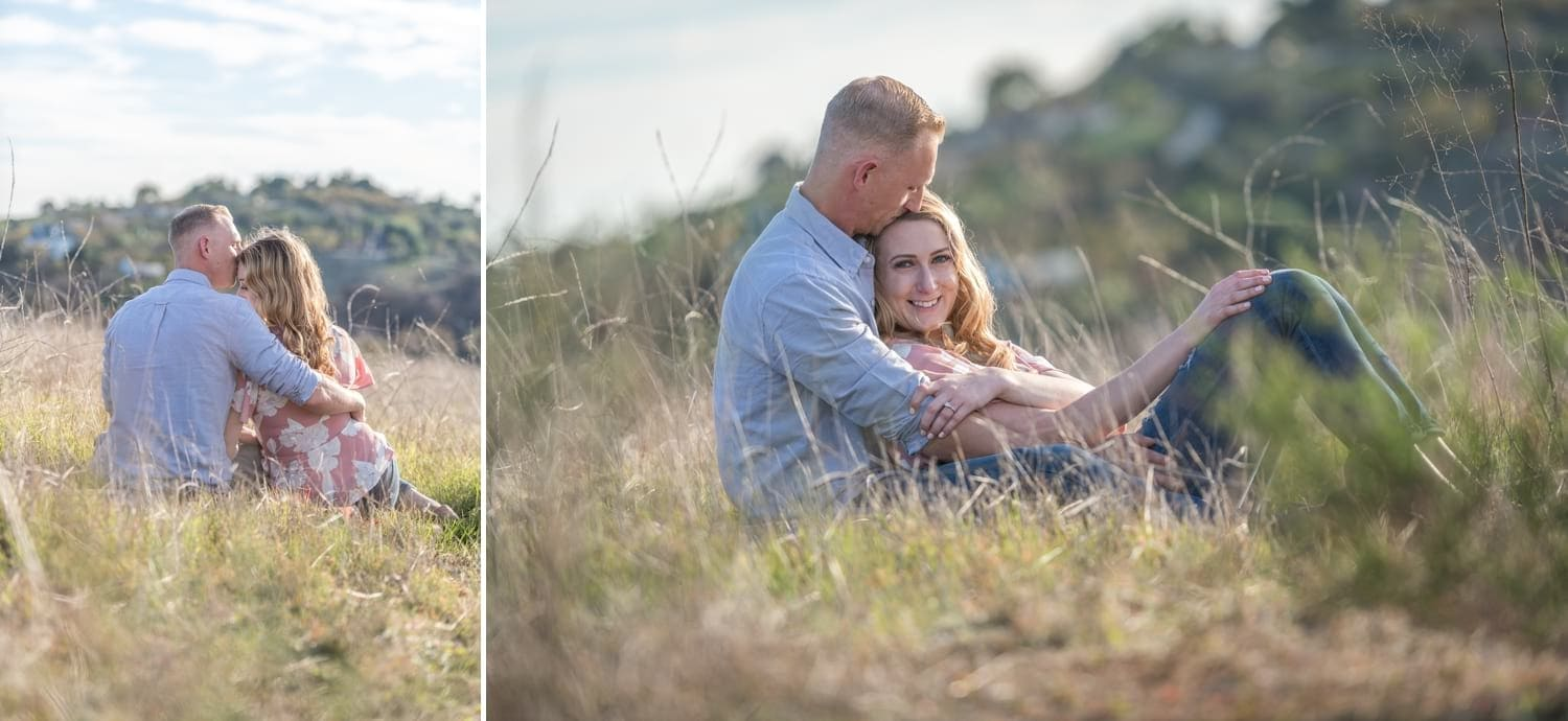 Couple laying down in a field for their engagement session.