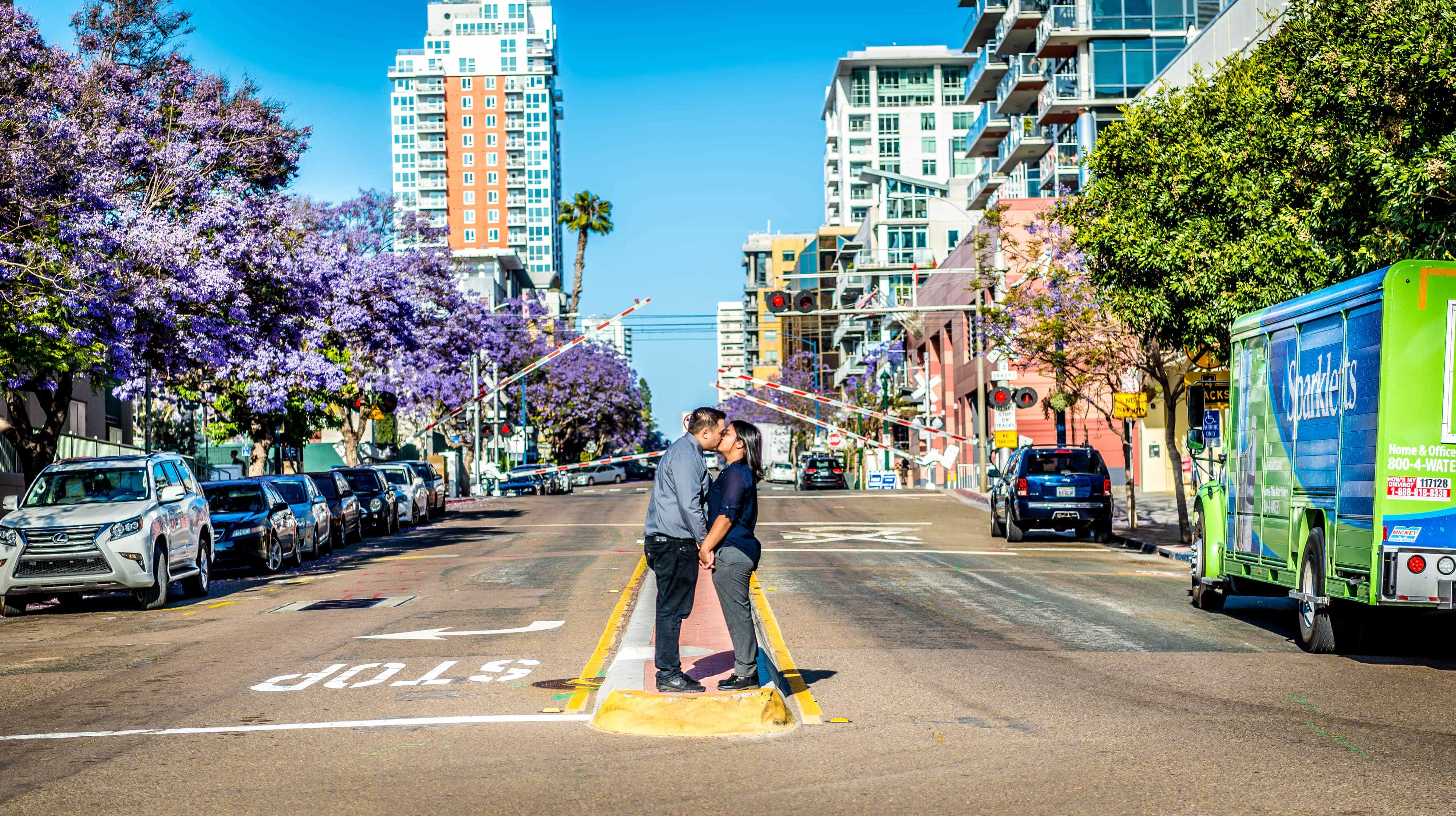 Bride and groom kissing in the middle of the street in San Diego.