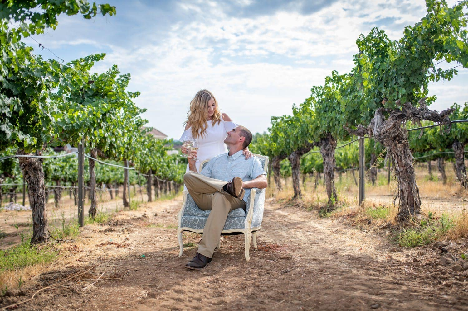 Couple sitting in a chair in the vines at Wilson Creek.