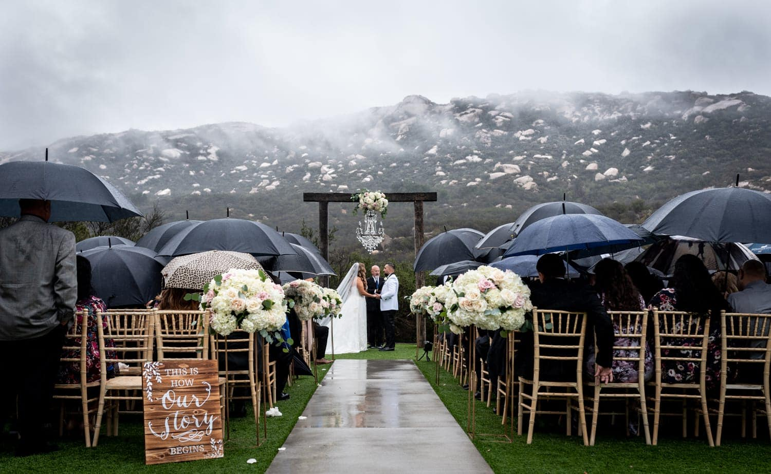 Wedding ceremony in the rain in San Diego, CA.