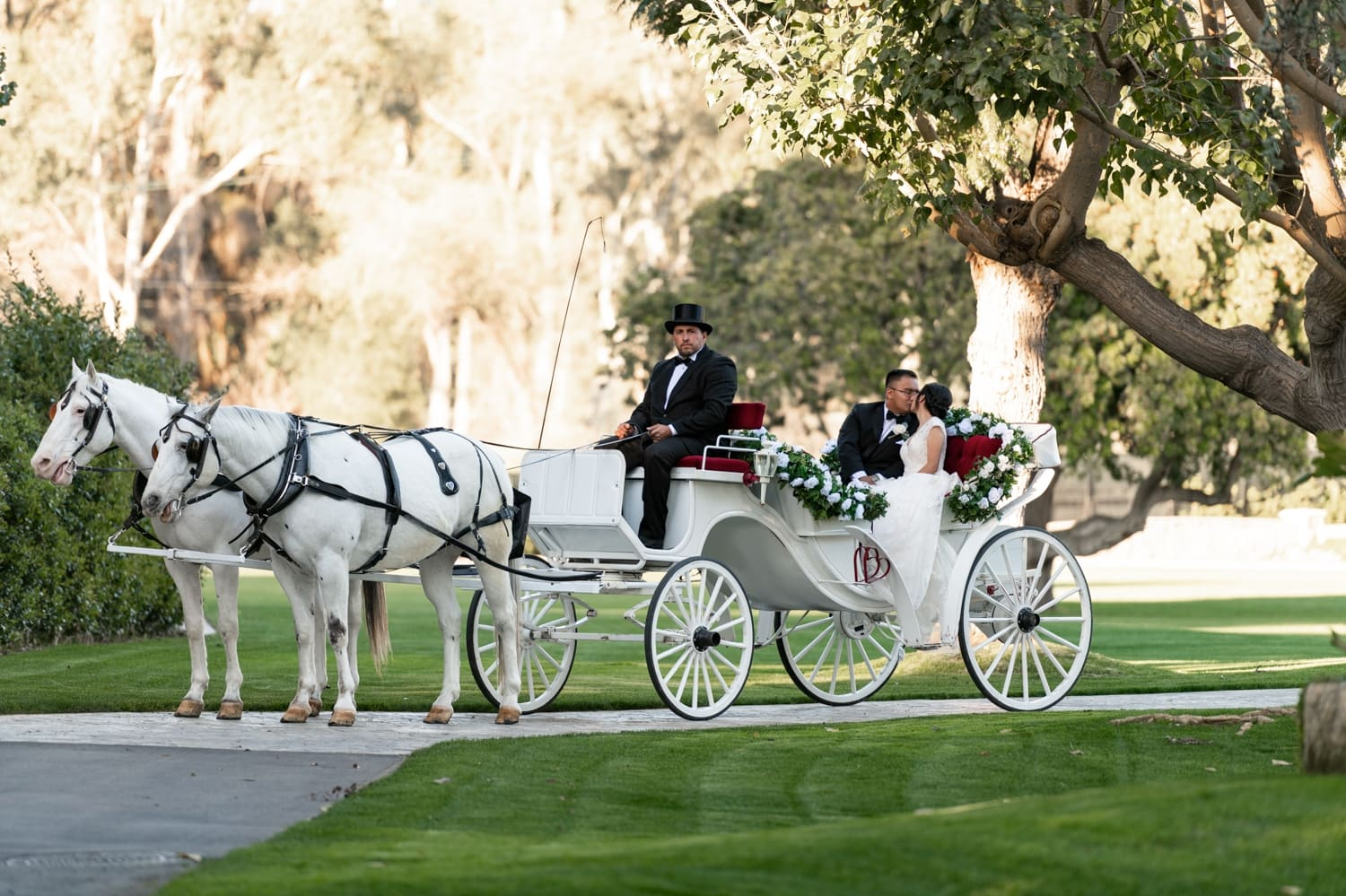 Bride and groom in a horse carriage at the Grand Tradition Estate.
