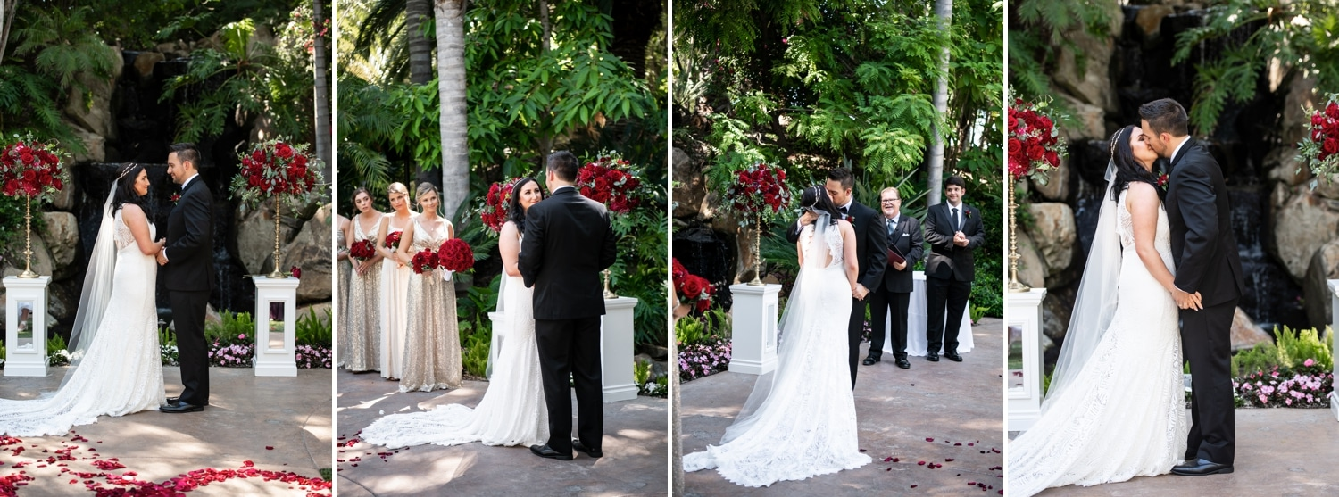 Bride and groom's first kiss during their wedding ceremony.