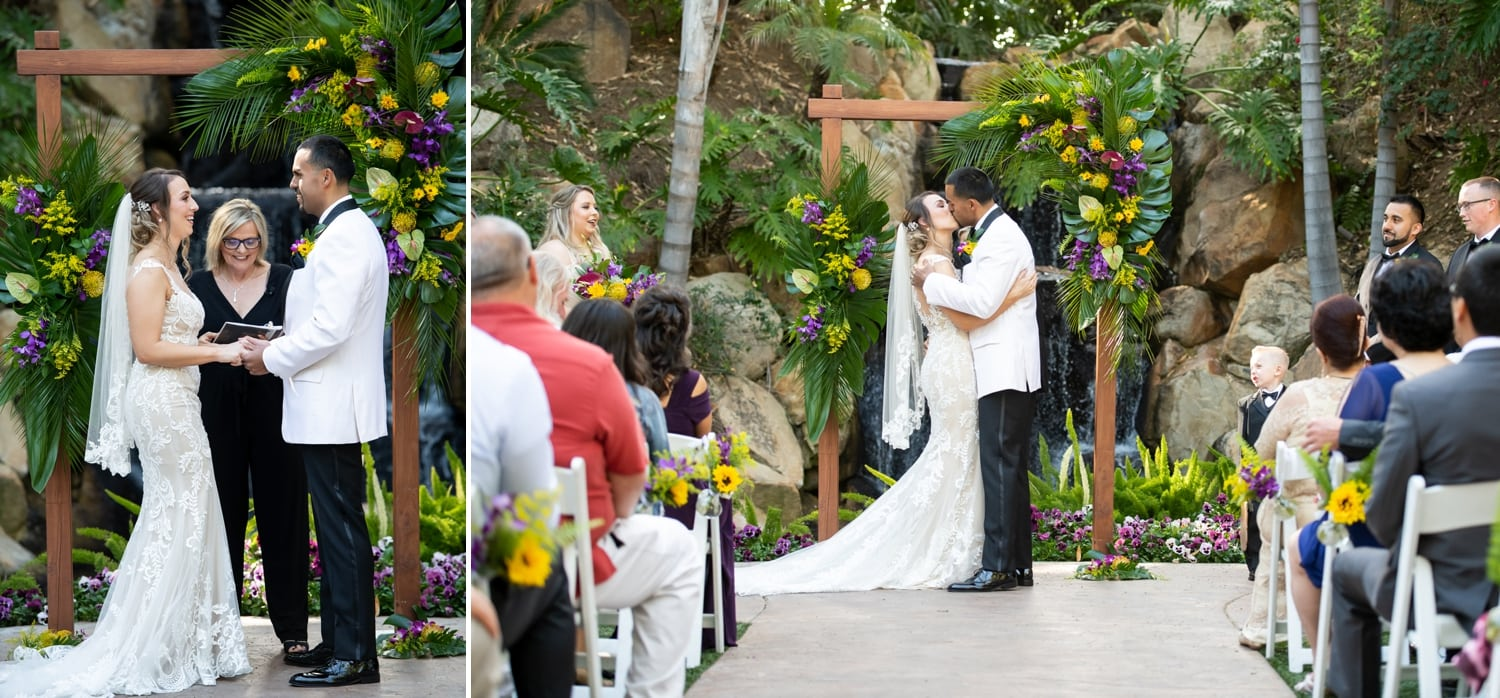 Bride and groom's first kiss at Arbor Terrace.