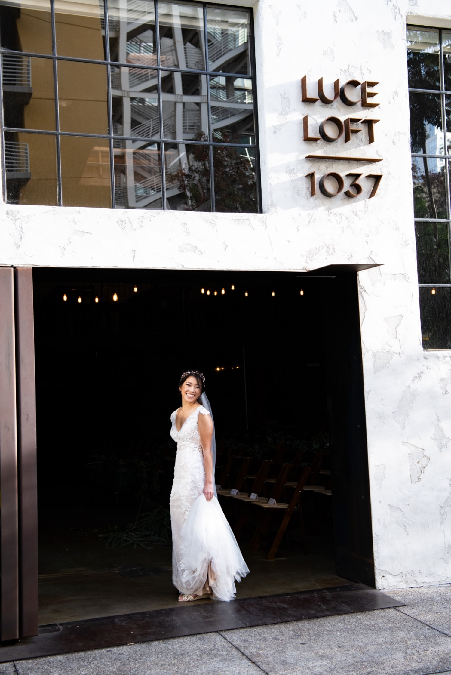 Bride in front of Luce Loft in San Diego, CA.