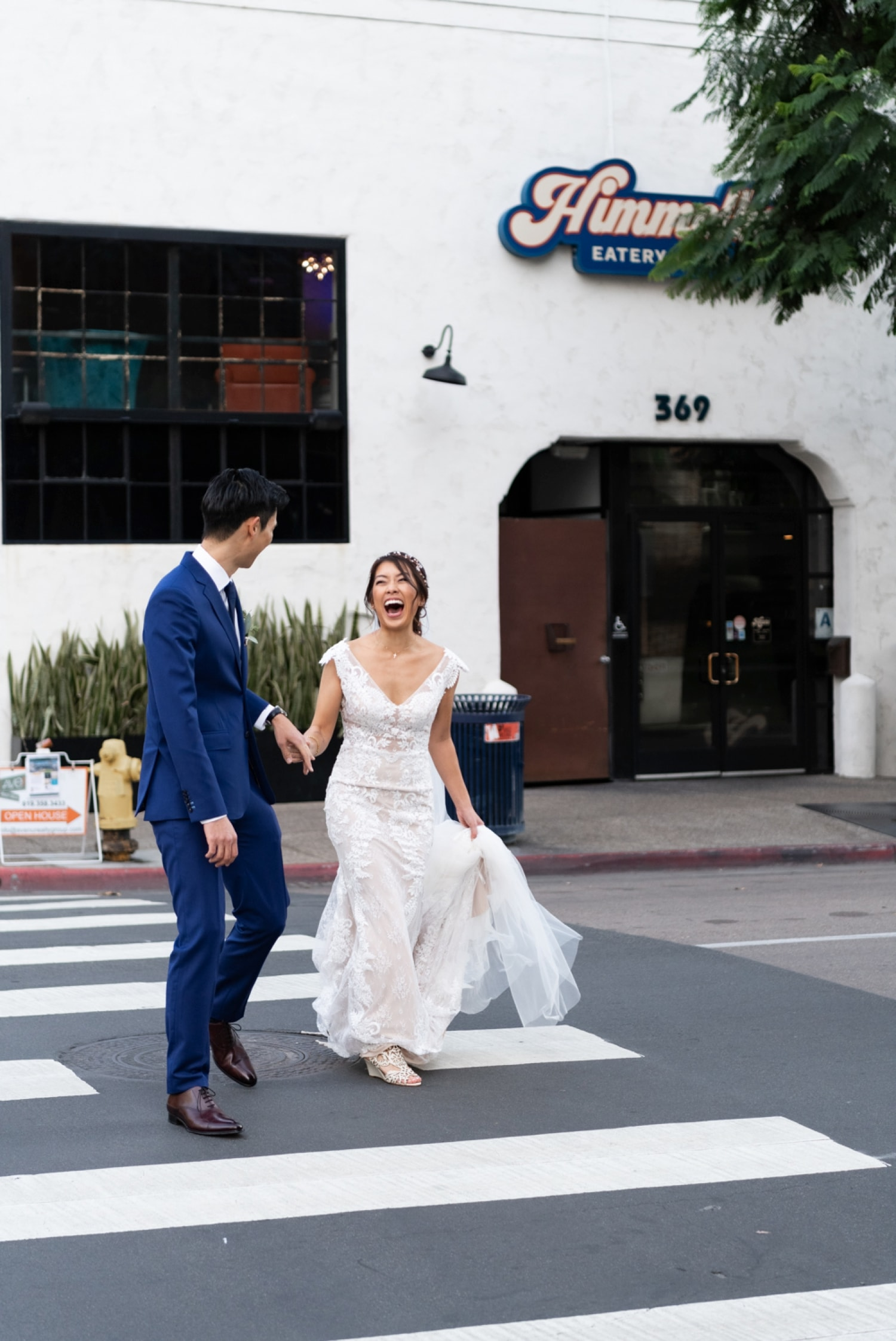 Bride and groom crossing the street in downtown San Diego.