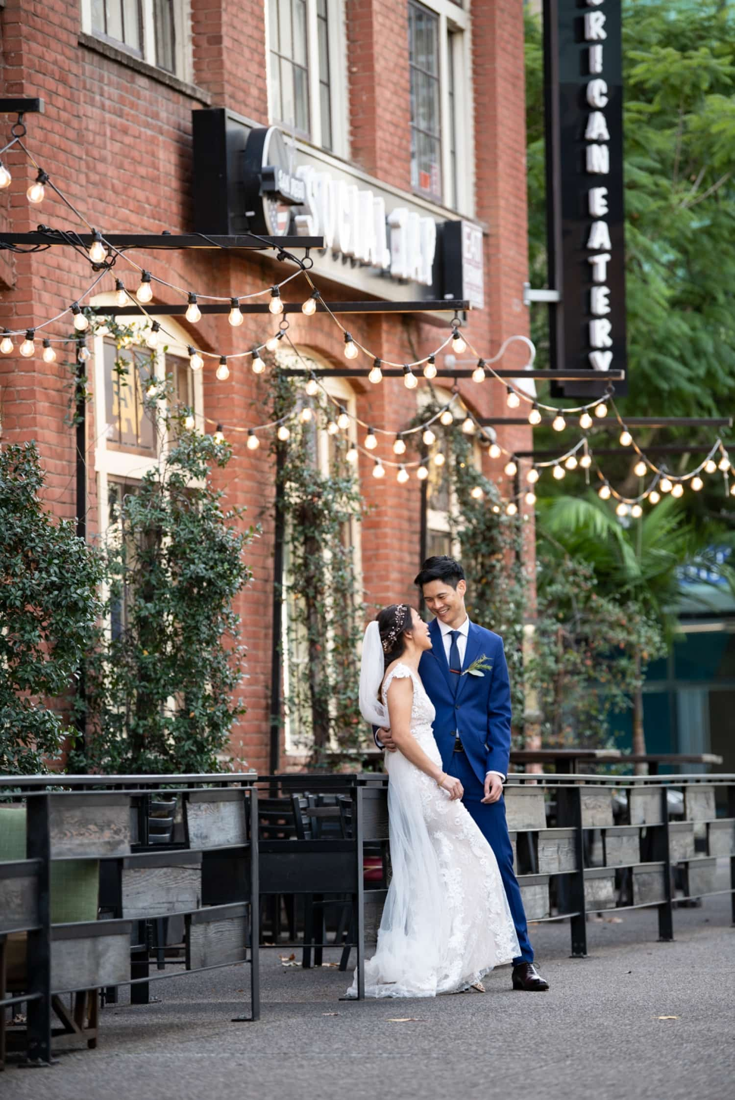 Bride and groom in front of American Eatery in downtown San Diego.