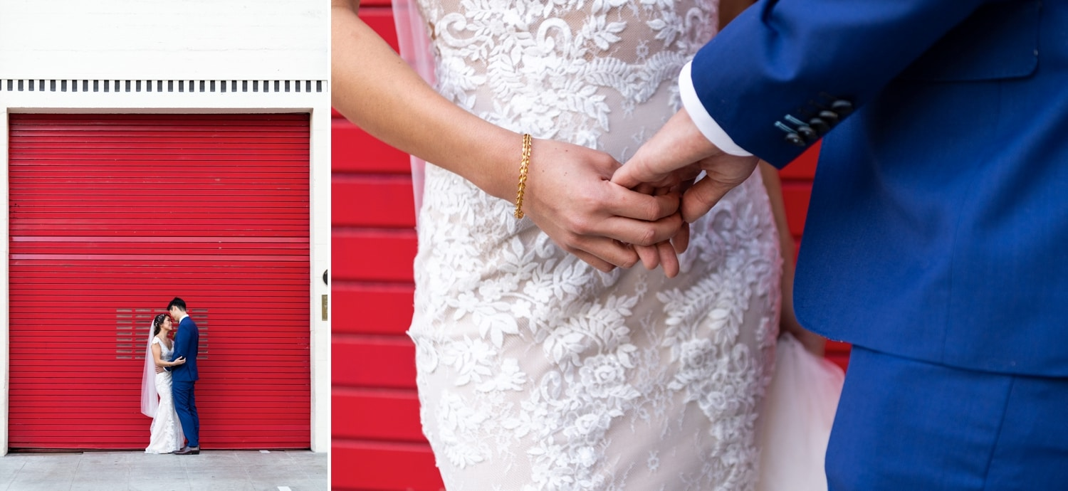 Bride and groom in front of big red door of San Diego Firehouse.