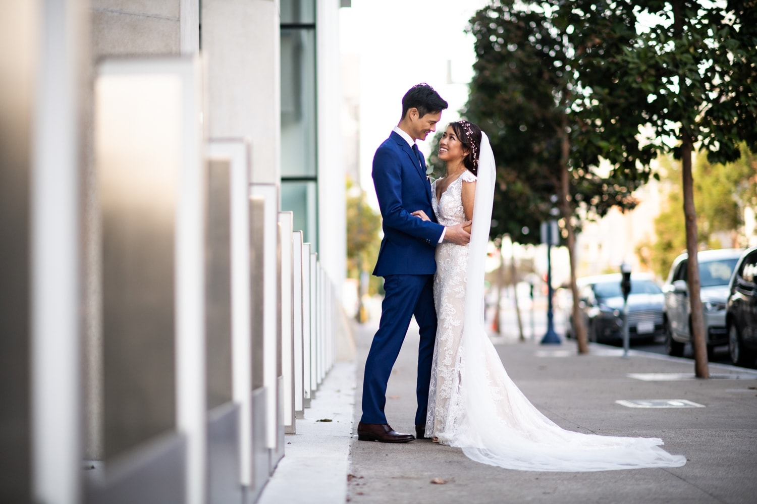 Bride and groom posing in downtown San Diego before their wedding.