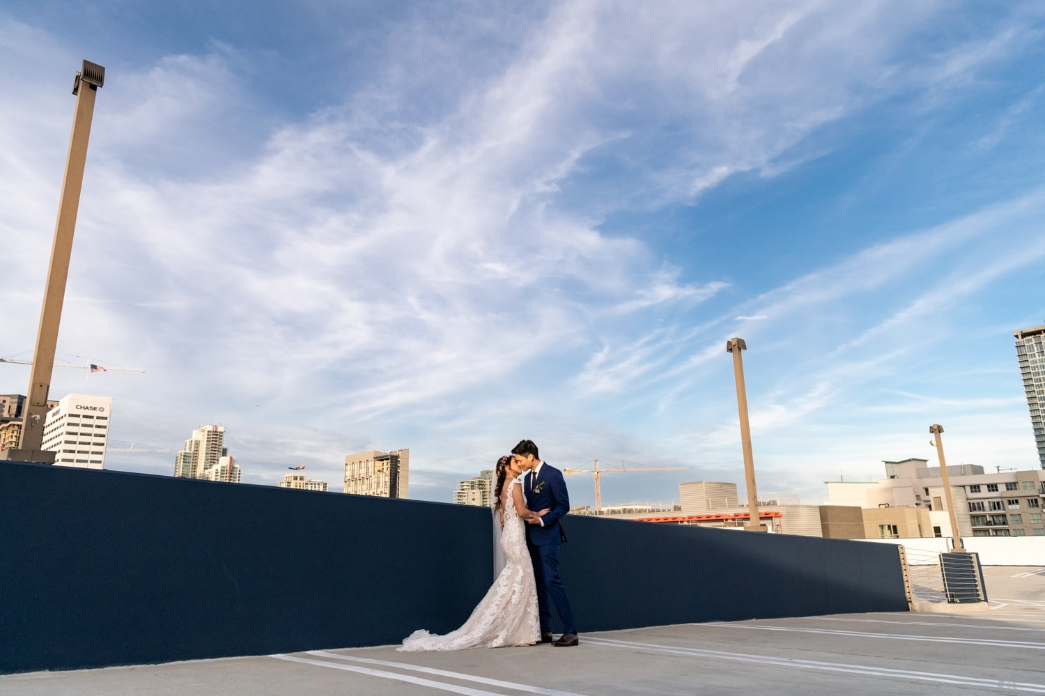 Bride and groom on a rooftop in San Diego after their wedding.