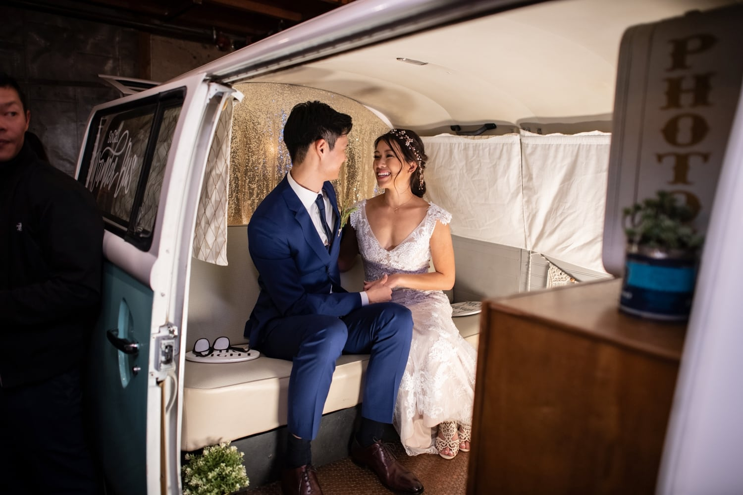 Bride and groom in a photo booth van in San Diego.