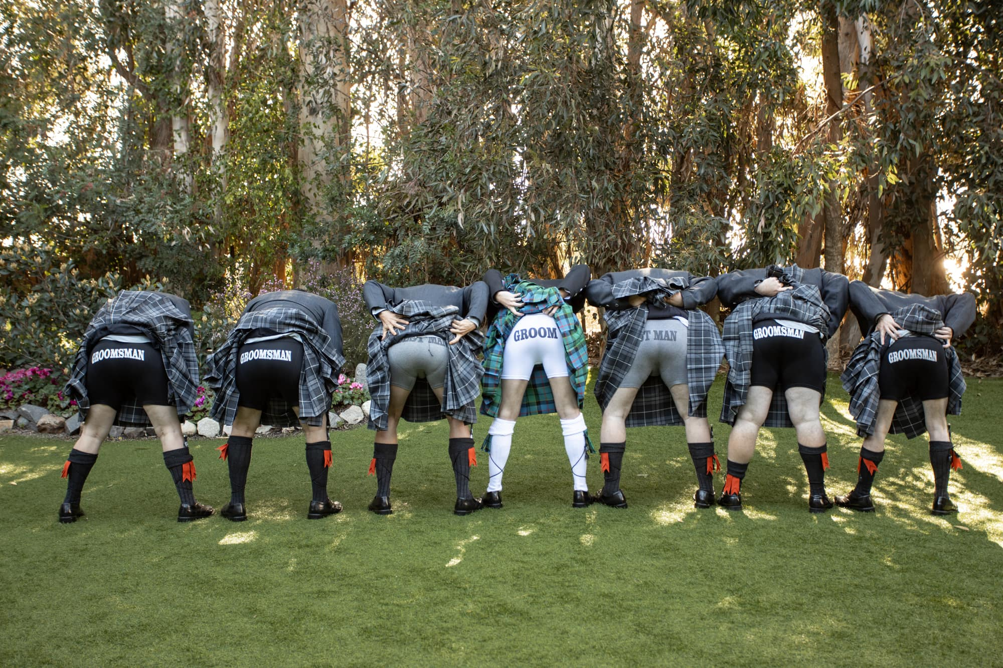 Groom and groomsmen in kilts with matching boxers at Twin Oaks Gardens wedding venue