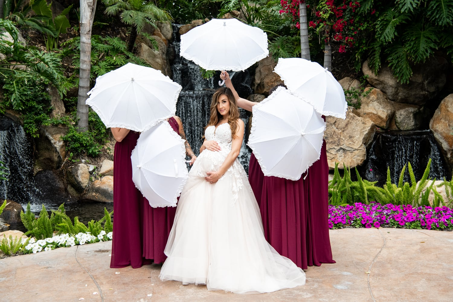 bridesmaids with parasols.