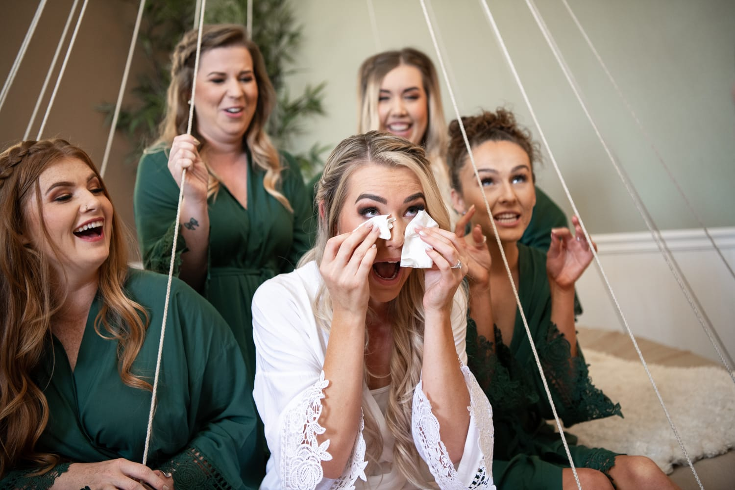 Bride crying with bridesmaids at Ethereal Gardens wedding venue in Escondido.
