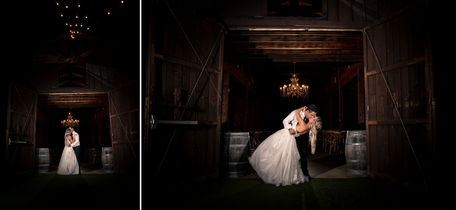 Bride and groom kissing at night outside of the barn at Ethereal Gardens in Escondido.