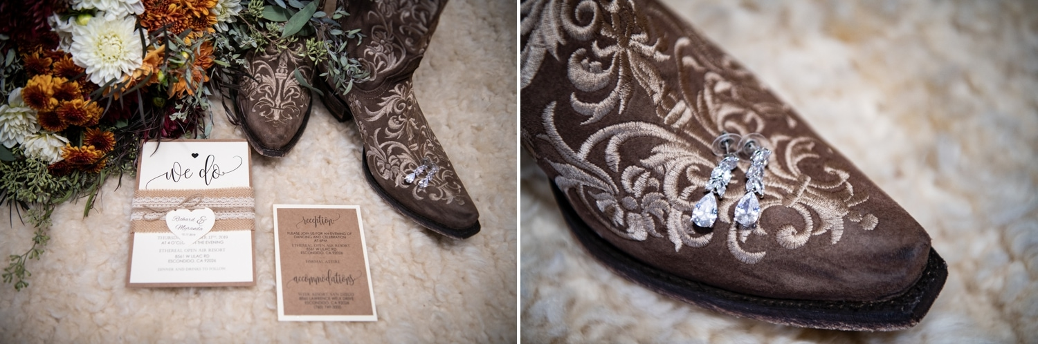 Brides invitation suite and earings with her cowgirl boots.
