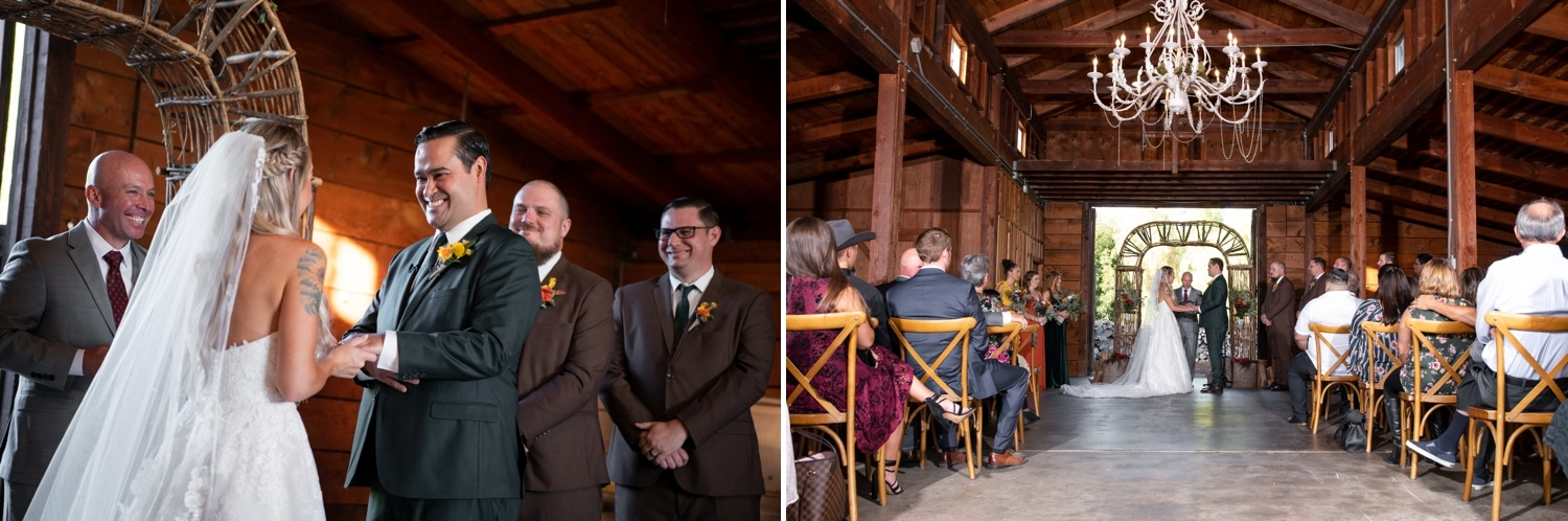 Bride and groom exchanging rings at their barn wedding ceremony.