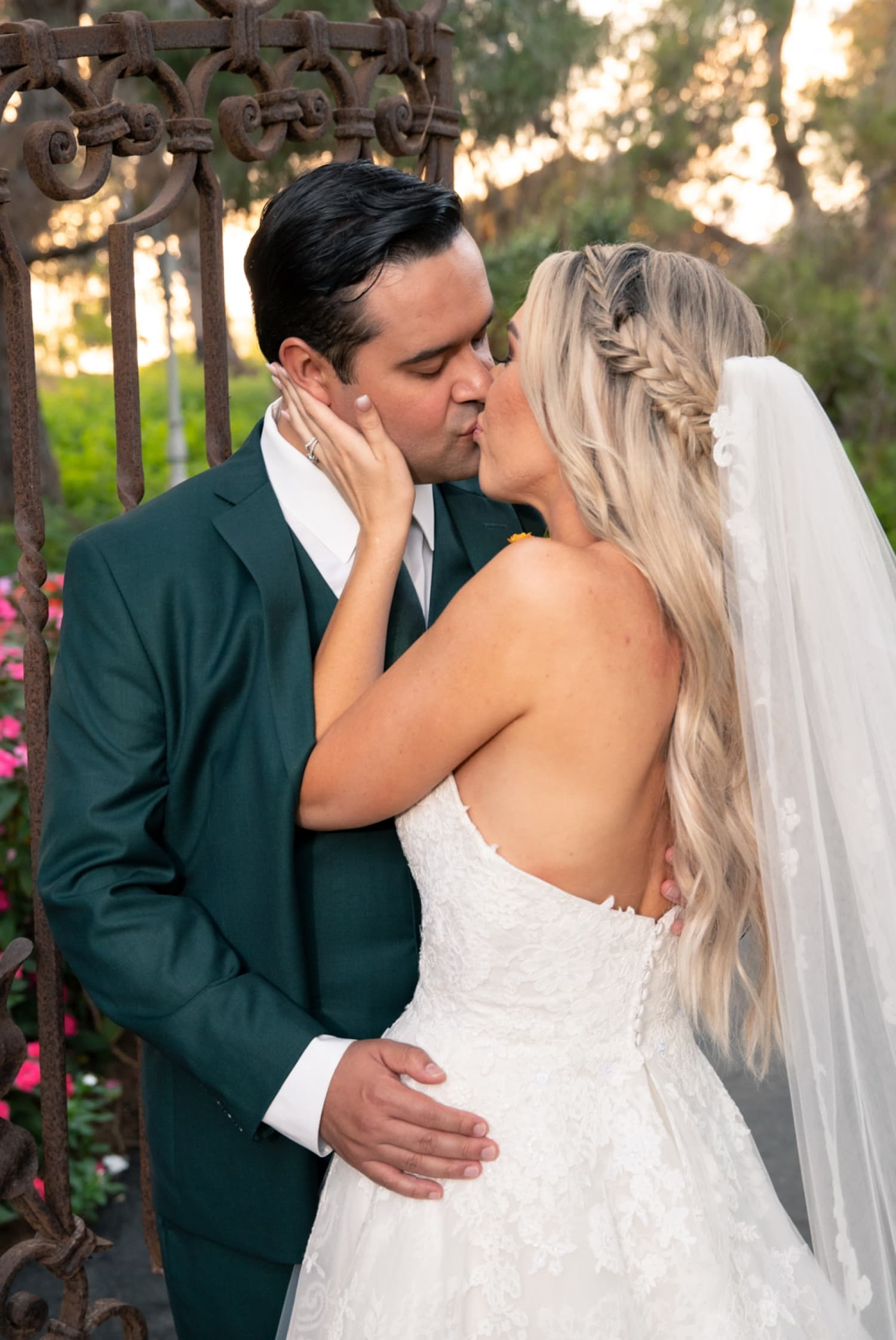 Bride kissing her husband at Ethereal Gardens.