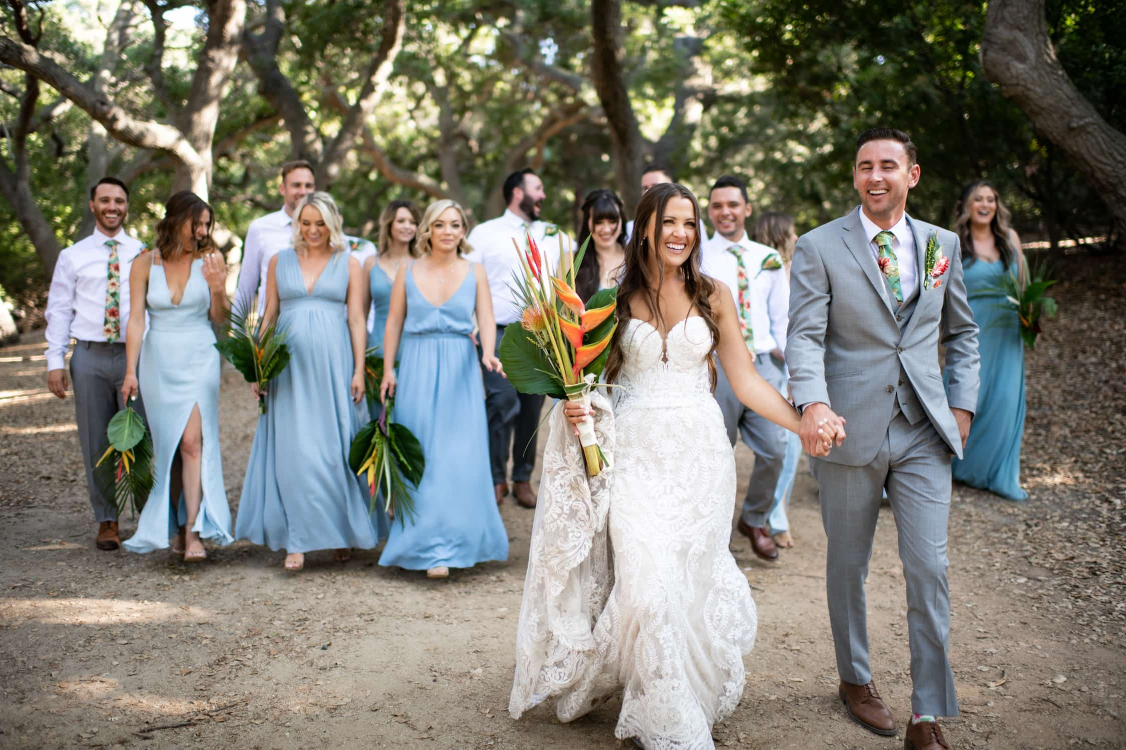 Bride and groom walking with bridal party in San Diego.