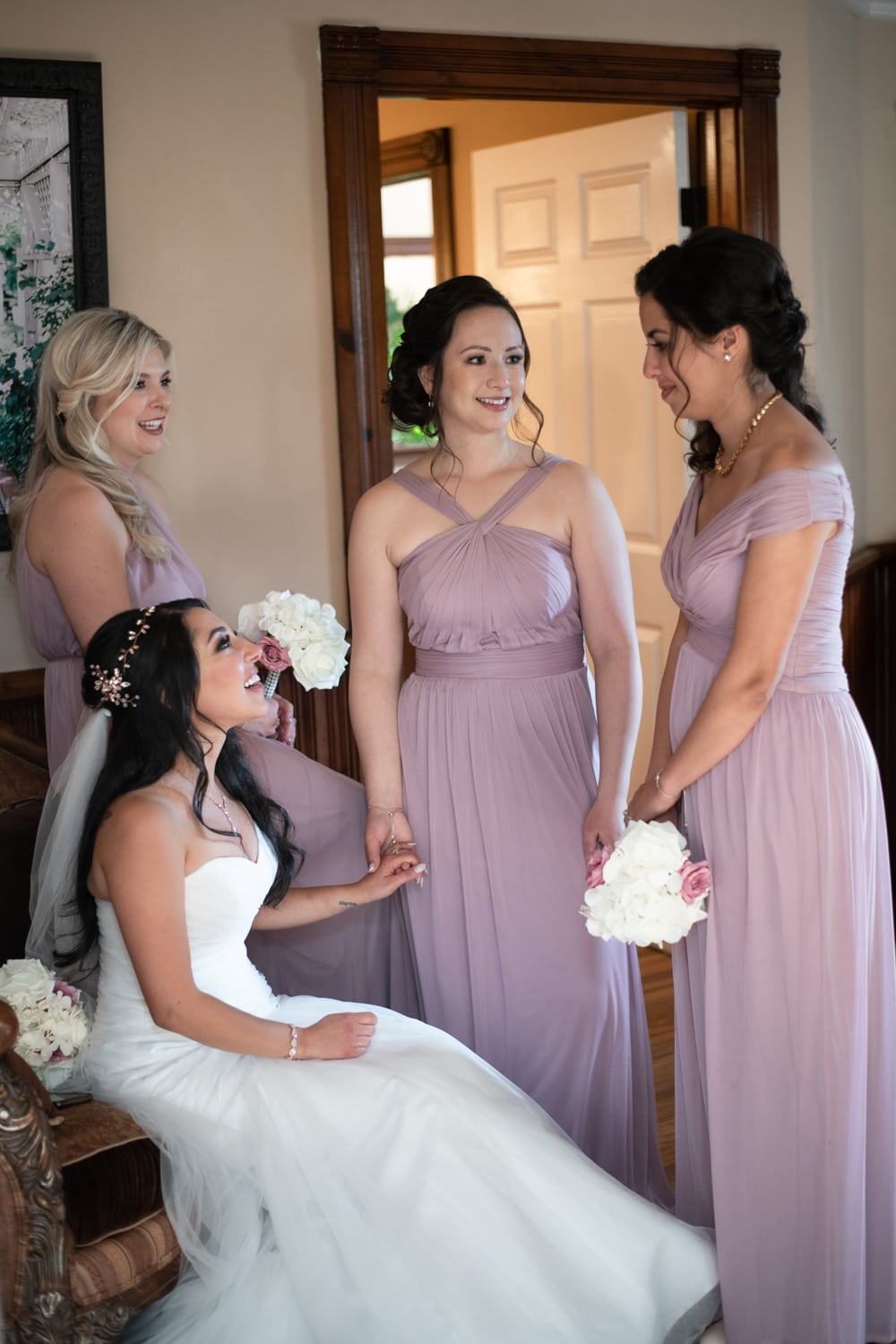 Bride and bridesmaids in bridal suite at Grand Tradition Estate.