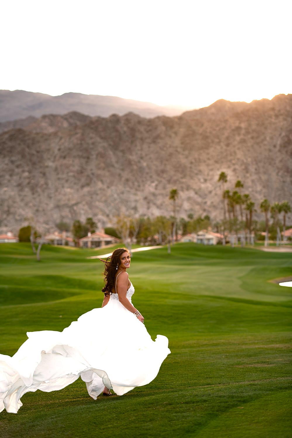 Bride running at the PGA West in Palm Springs.