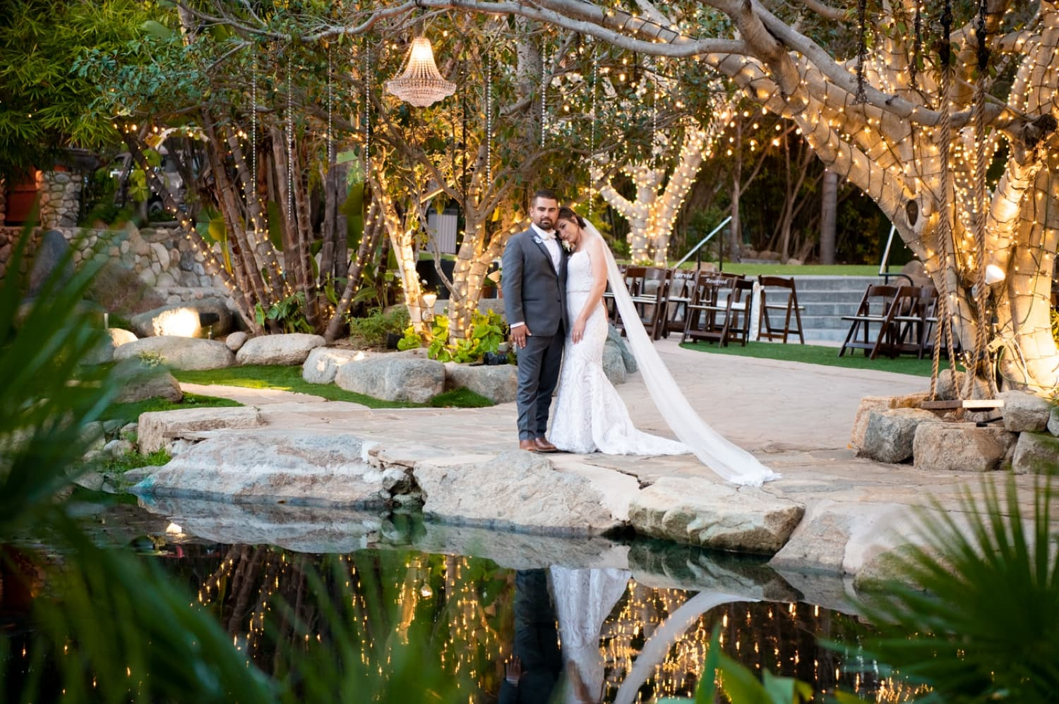 Bride and groom at the pond at Botanica.