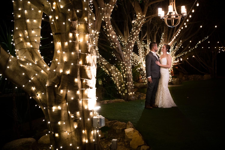 Bride and groom at night at Botanica wedding venue.