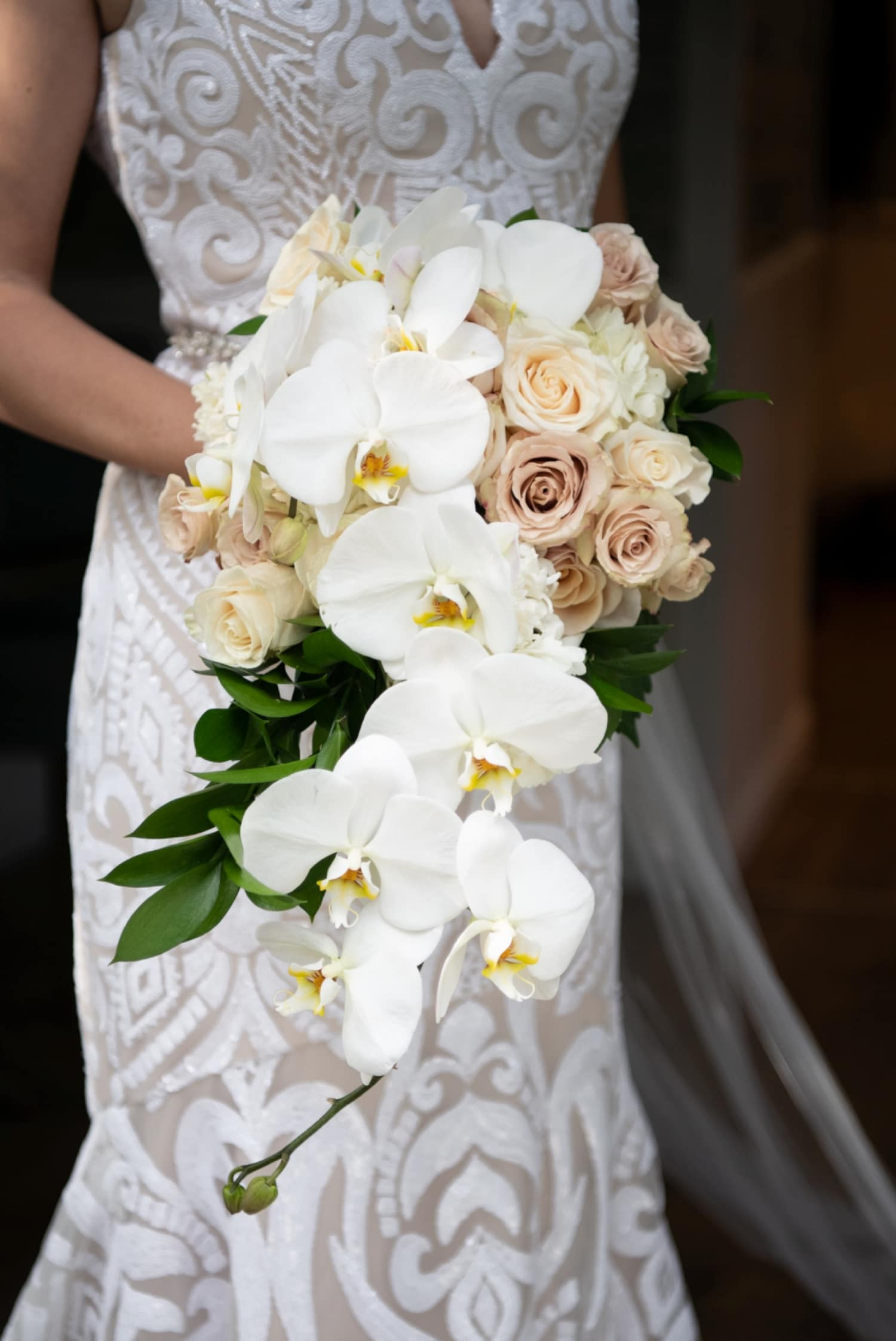 Bride holding her bouquet at her Botanica wedding