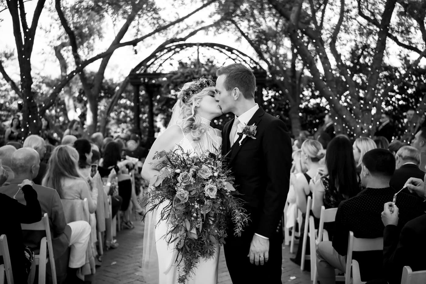 Bride and groom kissing at Padua Hills Theatre ceremony site.