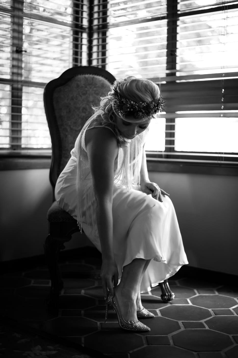 Bride putting on shoe at Padua Hills Theatre.