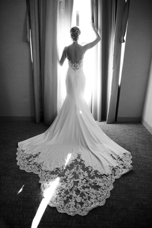 Bride in window in San Diego hotel