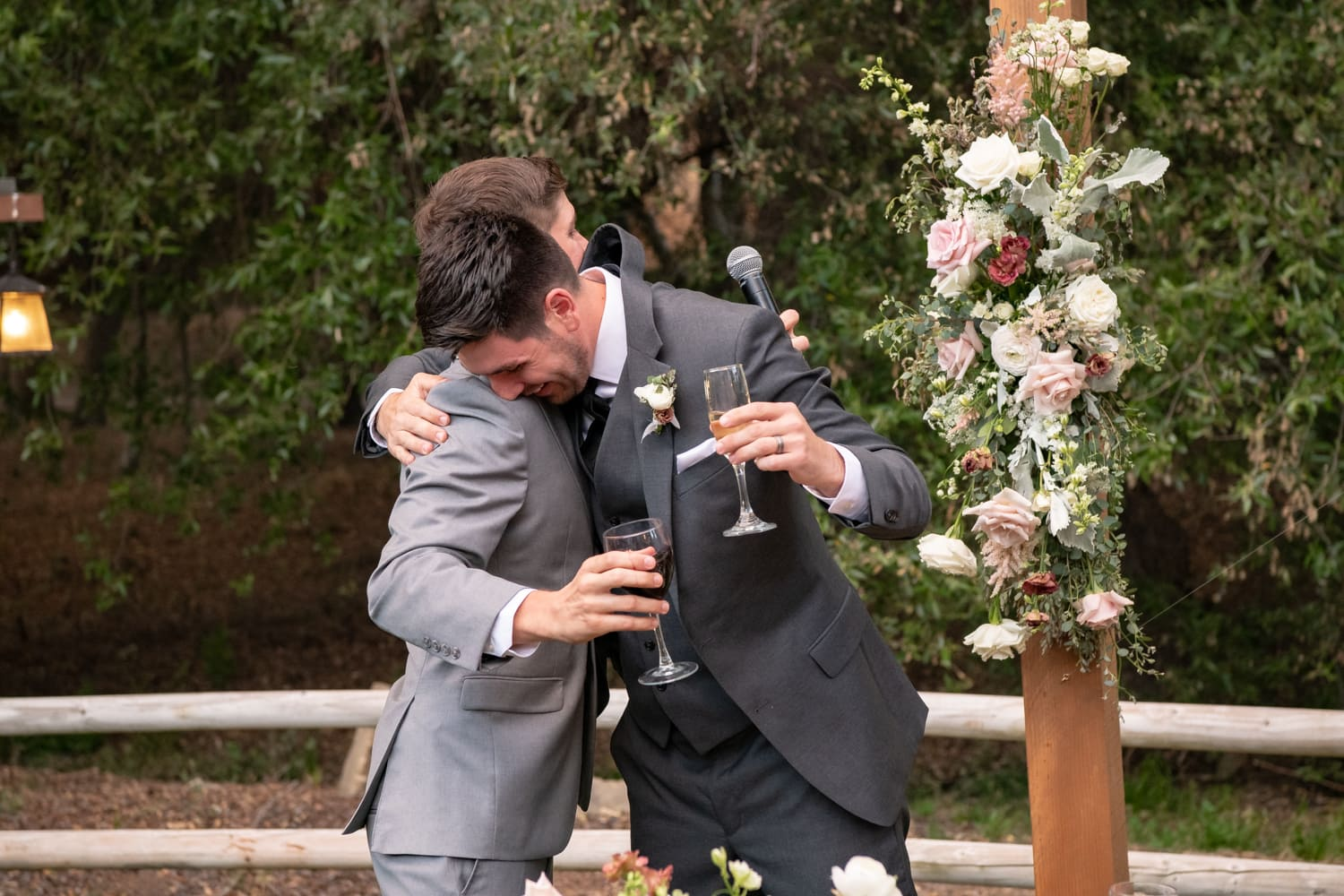 Groom hugging best man at The Stone House in Temecula, CA