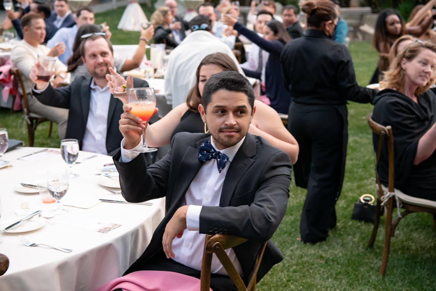 Guests toasting the couple at The Stone House in Temecula, CA