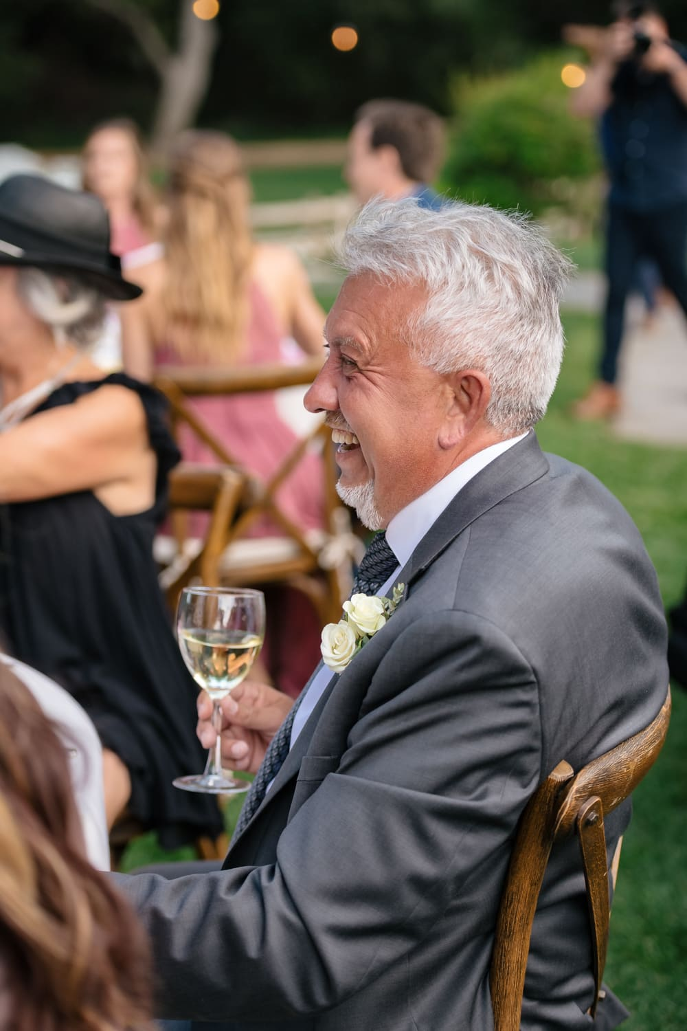 Guests laughing during toasts at Temecula Creek Inn wedding