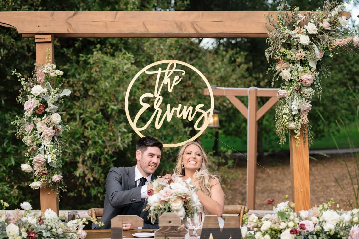 Couple at sweetheart table at The Stone House in Temecula, CA
