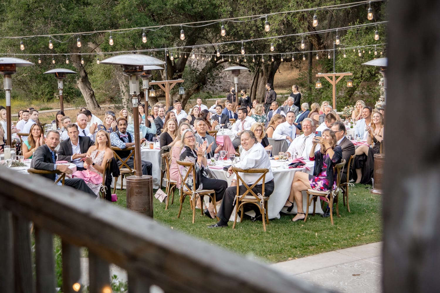 Guests cheering at The Stone House wedding venue reception
