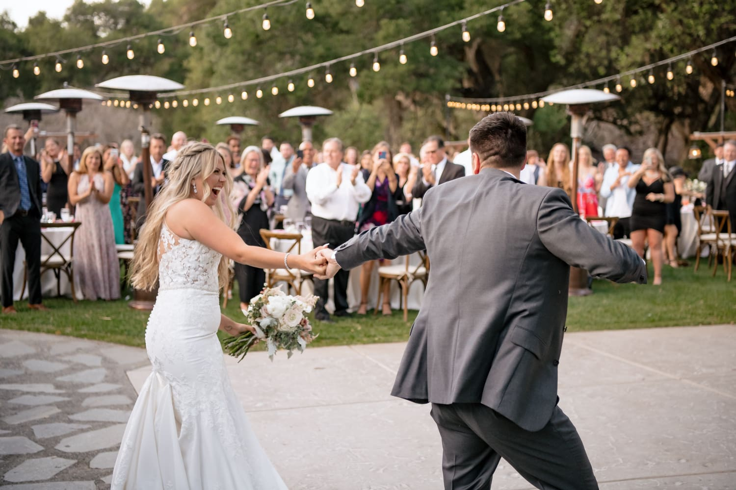 Couples grand entrance at The Stone House wedding venue