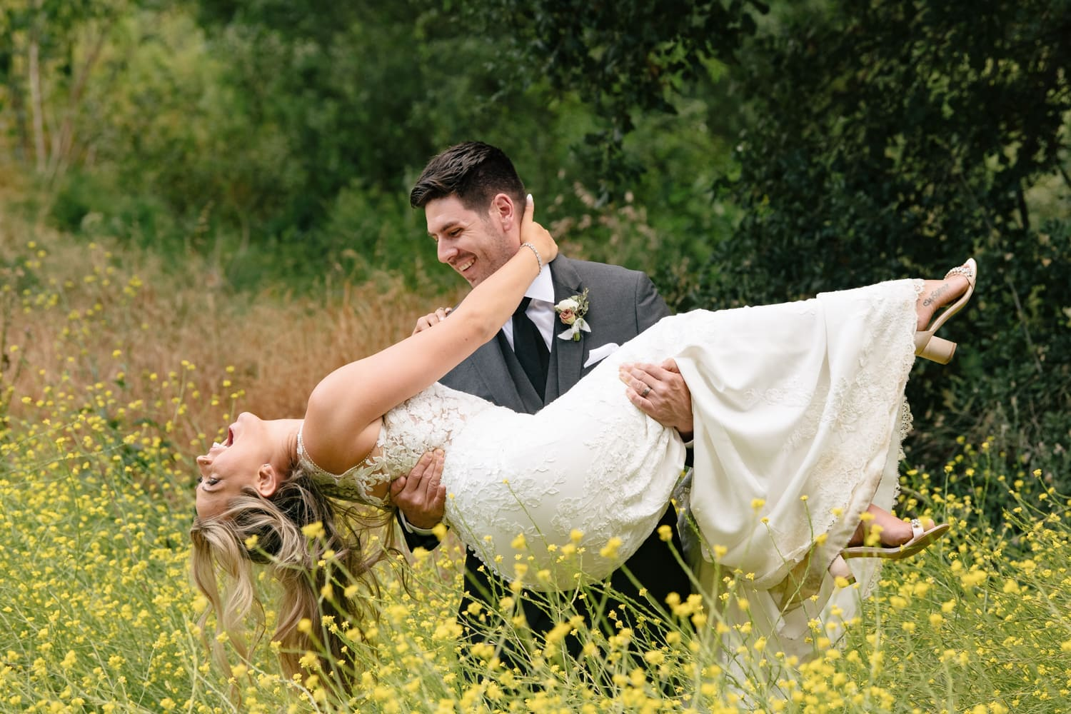 Groom carrying bride at The Stone House in Temecula, CA