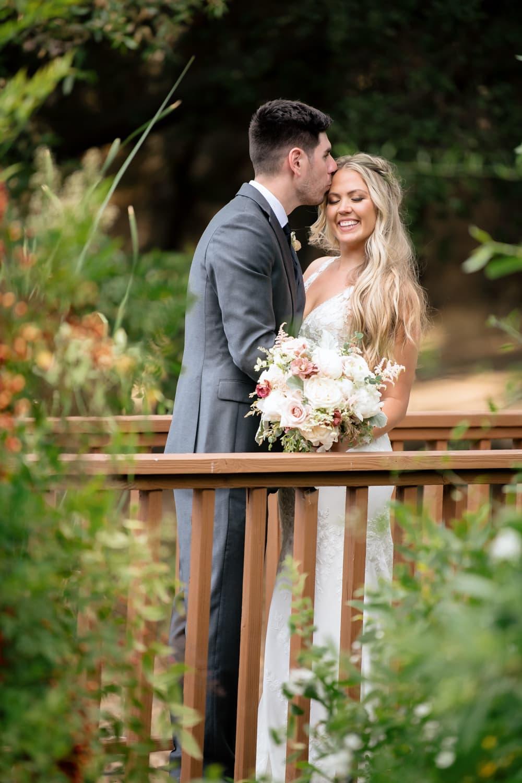 Bride and groom on bridge at Temecula Creek Inn