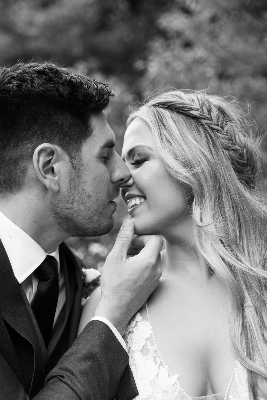 Bride and groom kissing at Temecula Creek Inn